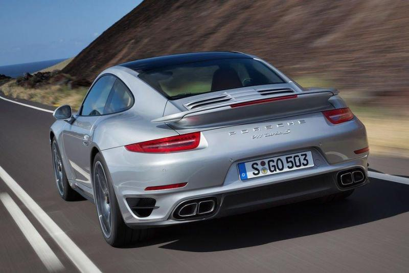 Cover for Porsche reveals next generation 911 Turbo, downplays power ratings?